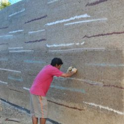 CLC Worker Finishing Rammed Earth Wall