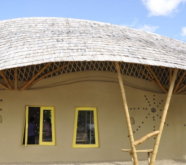Bamboo Tiles And Layers Form The Curved Roof Of An Office And House Unit Built By CLC.